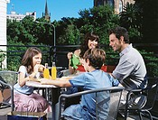 Family at a cafe outdoors