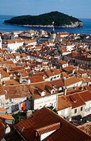 Rooftops of old town Dubrovnik with Lokrum Island in the Adriatic Sea behind the city. Croatia
