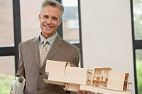 Architect with architectural model