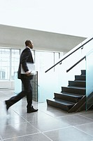 Businessman rushing up the stairs (thumbnail)