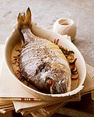 Sea bream with mushroom stuffing in roasting dish