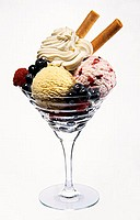 Icecream sundae: forest fruits & vanilla icecream, fruit,cream
