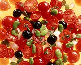Tomato salad with olives, beans & onions (close-up)