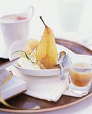Poached pear with ice cream and lime wedges