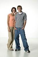 Two teenage friends (16-17) side by side, posing in studio, portrait