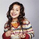 Girl (7-9) wearing woolen sweater, portrait