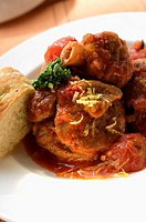 Osso buco with tomatoes and focaccia