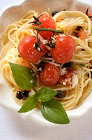 Spaghetti with cherry tomatoes, olives, cheese and basil