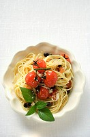 Spaghetti with cherry tomatoes, olives, cheese and basil (thumbnail)