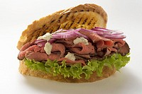Roast beef and onion sandwich