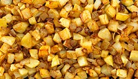 Fried potatoes with onions filling the picture