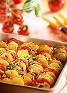 Potato and tomato gratin with pine nuts