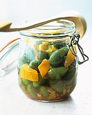Pickled green olives in a preserving jar
