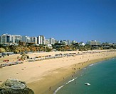 Praia da Rocha beach and high-rise buildings. Algarve. Portugal