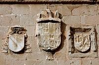 Coats of arms in a Plazuela de la Cárcel façade. Sigüenza. Guadalajara province. Castilla La Mancha. Spain