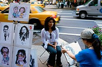 An Indian tourist having her portrait taken by a street artist.  Manhattan, NY, USA