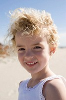 Smiling girl posing on beach