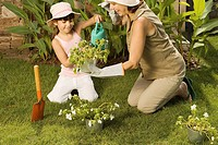 Girl and grandmother gardening
