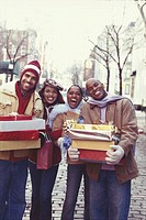 Two couples with presents smiling, portrait