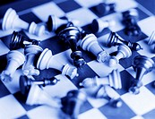 Chess pieces scattered on board (digital enhancement)