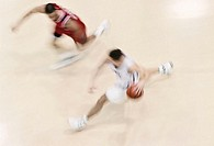 Two male basketball players running, overhead view (blurred moition)