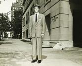 Man in full posing on Manhattan street, New York City, (B&W), (Portrait)