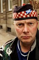 Portrait of a Scottish football fan after celebrating a match, Glasgow, Scotland, UK.