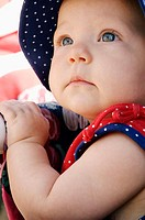 A toddler is watching a Fourth of July Parade in a small town in Oregon, USA