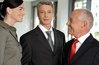 Business woman talking with two business men