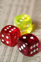 Three dices on a business paper, close-up