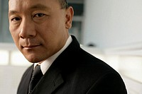 Portrait of an asian businessman in a hall