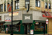 Pars Persian grocery store on corner of Andersonville neighborhood street, area with strong Swedish roots, people look in store windows. Chicago. Illi...