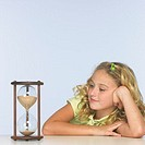 Girl Looking at Hourglass