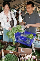 Farmers market, produce, Asian couple, shopping. Coconut Grove. Florida. USA.