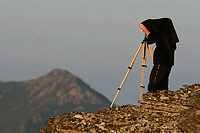 Landscape photographer with technical camera 9x12 at Courel mountains. Lugo province, Galicia, Spain