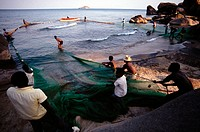 Fishermen pulling nets at at lake Malawi. Malawi