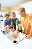 Teenage boys in kitchen