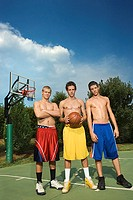 Teenage boys on basketball court