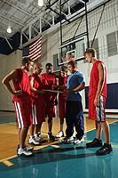 Basketball team and coach
