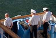 Ships Captain and officers on the bridge wing of a passenger ship