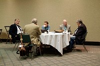 Professional businessmen meet to discuss different business situations