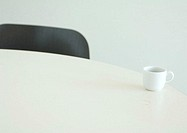 Coffee cup on edge of table