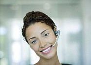 Woman wearing headset and smiling