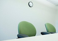 Empty chairs at conference table