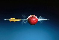 Crossbow's bolt shot through a red apple