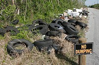 Ilegal dumping site, roadside, tires, appliances, trash, pollution, litter. Homestead. Florida. USA