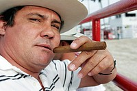 Hispanic man, unlit cigar. Championship Rodeo. Homestead. Florida. USA.