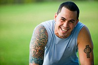 Portrait of Caucasian man in his 20´s with tatoos smiling