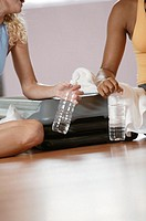 Women drinking water after exercising.