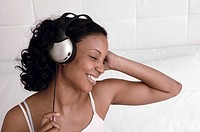 Woman listening to music through headphones.